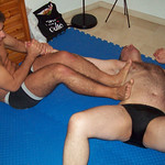 a hairy male wrestling legs arms lock gay bars